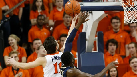 <p>               Virginia guard Ty Jerome (11) takes a shot over Pittsburgh guard Sidy N'Dir, right, during the first half of an NCAA college basketball game in Charlottesville, Va., Saturday, March 2, 2019. (AP Photo/Steve Helber)             </p>