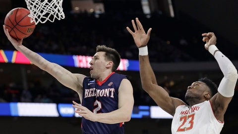 <p>               Belmont guard Grayson Murphy (2) gets off a shot ahead of Maryland 's Bruno Fernando (23) during the first half of a first round men's college basketball game in the NCAA Tournament in Jacksonville, Fla., Thursday, March 21, 2019. (AP Photo/John Raoux)             </p>