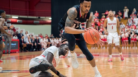 <p>               Gardner Webb guard David Efianayi (11) takes ball away from Radford forward Mawdo Sallah (20 during the first half of the Big South conference NCAA basketball championship game in Radford, Va., Sunday, March 10, 2019. (AP Photo/Lee Luther Jr.)             </p>