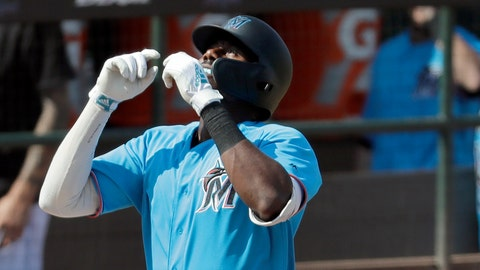 <p>               Miami Marlins' Lewis Brinson looks skyward as he arrives home after hitting a solo home run during the fifth inning of an exhibition spring training baseball game against the Washington Nationals Monday, March 4, 2019, in Jupiter, Fla. The home run was the second of the game for Brinson. (AP Photo/Jeff Roberson)             </p>