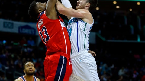 <p>               Charlotte Hornets forward Frank Kaminsky, right, shoots over Washington Wizards center Thomas Bryant (13) in the first half of an NBA basketball game in Charlotte, N.C., Friday, March 8, 2019. (AP Photo/Nell Redmond)             </p>