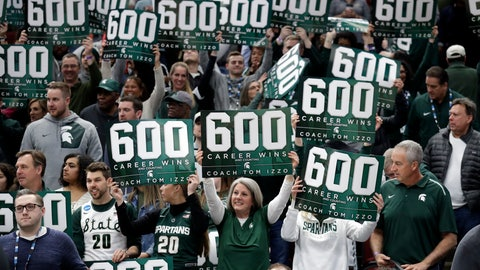 <p>               Michigan State fans celebrate head coach Tom Izzo's 600th win after an NCAA college basketball game against Ohio State in the quarterfinals of the Big Ten Conference tournament, Friday, March 15, 2019, in Chicago. Michigan State won 77-70. (AP Photo/Nam Y. Huh)             </p>