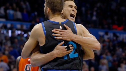 <p>               Dallas Mavericks forward Dwight Powell, right, celebrates with teammate Maximilian Kleber, left, following an NBA basketball game against the Oklahoma City Thunder Sunday, March 31, 2019, in Oklahoma City. (AP Photo/Sue Ogrocki)             </p>