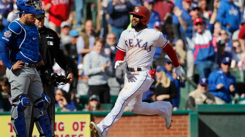 <p>               Texas Rangers' Delino DeShields, right, crosses home plate with Chicago Cubs catcher Victor Caratini, left, looking on after hitting a grand slam during the fourth inning of a baseball game in Arlington, Texas, Sunday, March 31, 2019. (AP Photo/LM Otero)             </p>