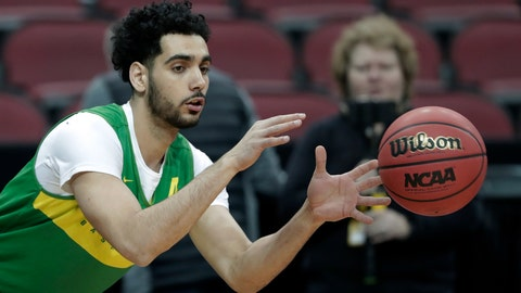 <p>               Oregon's Ehab Amin catches a pass during practice for the NCAA men's college basketball tournament, Wednesday, March 27, 2019, in Louisville, Ky. (AP Photo/Michael Conroy)             </p>
