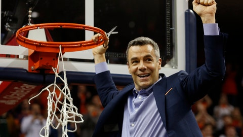 <p>               Virginia head coach Tony Bennett holds a piece of the net after a victory over Louisville after an NCAA college basketball game in Charlottesville, Va., Saturday, March 9, 2019. (AP Photo/Steve Helber)             </p>