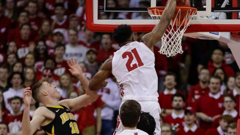 <p>               Wisconsin's Khalil Iverson (21) dunks past Iowa's Joe Wieskamp (10) during the first half of an NCAA college basketball game Thursday, March 7, 2019, in Madison, Wis. (AP Photo/Andy Manis)             </p>