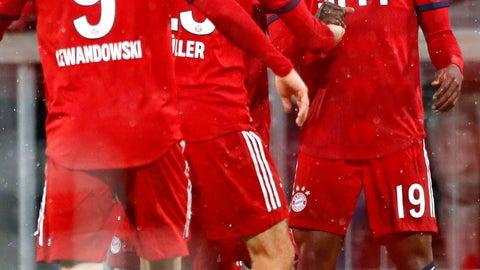 <p>               Bayern's Alphonso Davies, right, celebrates after scoring his side's sixth goal during the German Bundesliga soccer match between FC Bayern Munich and 1. FSV Mainz 05 in Munich, Germany, Sunday, March 17, 2019. (AP Photo/Matthias Schrader)             </p>