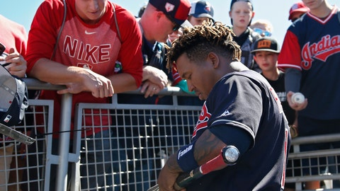 <p>               Cleveland Indians' Jose Ramirez signs a bat for a fan before a spring training baseball game against the Colorado Rockies, Thursday, March 14, 2019, in Goodyear, Ariz. (AP Photo/Sue Ogrocki)             </p>