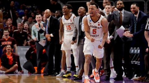 <p>               Virginia Tech guard Justin Robinson celebrates during the first half of the team's first-round game against Saint Louis in the NCAA men's college basketball tournament Friday, March 22, 2019, in San Jose, Calif. (AP Photo/Jeff Chiu)             </p>