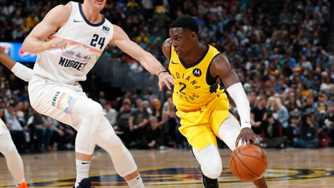 <p>               Indiana Pacers guard Darren Collison, right, drives the lane past Denver Nuggets forward Mason Plumlee during the first half of an NBA basketball game Saturday, March 16, 2019, in Denver. (AP Photo/David Zalubowski)             </p>