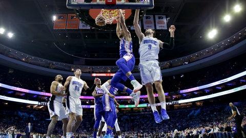<p>               Philadelphia 76ers' Ben Simmons, center, dunks the ball past Orlando Magic's Nikola Vucevic, right, during the first half of an NBA basketball game, Tuesday, March 5, 2019, in Philadelphia. (AP Photo/Matt Slocum)             </p>
