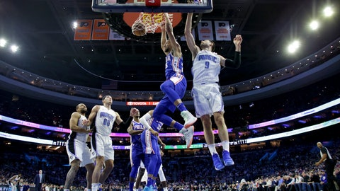 <p>               Philadelphia 76ers' Ben Simmons, center, dunks the ball past Orlando Magic's Nikola Vucevic, right, during the first half of an NBA basketball game, Tuesday, March 5, 2019, in Philadelphia. (AP Photo/Matt Slocum)             </p>
