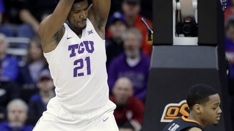 <p>               TCU's Kevin Samuel gets past Oklahoma State's Curtis Jones for adunk during the first half of an NCAA college basketball game in the Big 12 men's tournament Wednesday, March 13, 2019, in Kansas City, Mo. (AP Photo/Charlie Riedel)             </p>