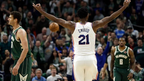<p>               Philadelphia 76ers' Joel Embiid (21) reacts after making a shot during the second half of the team's NBA basketball game against the Milwaukee Bucks on Sunday, March 17, 2019, in Milwaukee. The 76ers won 130-125. (AP Photo/Aaron Gash)             </p>