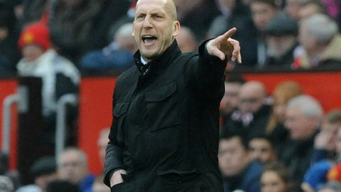 <p>               FILE - In this file photo dated Saturday, Jan. 7, 2017, Reading's manager Jaap Stam, gestures to his team from the sidelines during the English FA Cup Third Round match against Manchester United at Old Trafford in Manchester, England.  It is announced Wednesday March 6, 2019, that Stam has been appointed head coach of Dutch soccer team Feyenoord starting next season. (AP Photo/Rui Vieira, FILE)             </p>