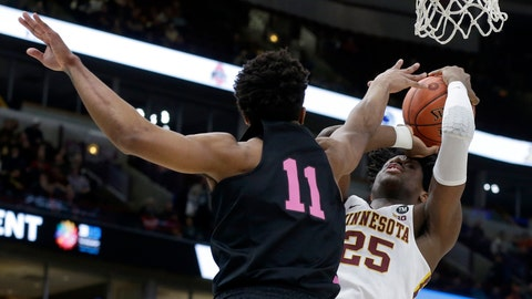 <p>               Minnesota's Daniel Oturu (25) takes a shot against Penn State's Lamar Stevens (11) during the first half of an NCAA college basketball game in the second round of the Big Ten Conference tournament, Thursday, March 14, 2019, in Chicago. (AP Photo/Kiichiro Sato)             </p>