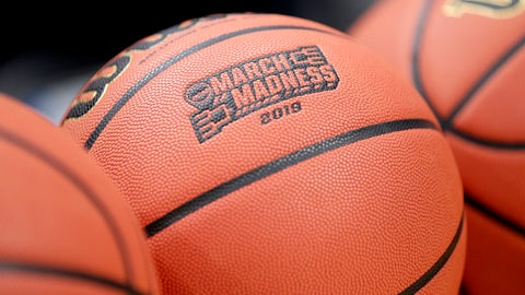 <p>               A basketball with March Madness 2019 sits in a rack before Michigan practice at the NCAA college basketball tournament in Des Moines, Iowa, Wednesday, March 20, 2019. (AP Photo/Nati Harnik)             </p>