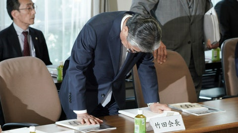 <p>               International Olympics Committee member and head of the Japanese Olympic Committee Tsunekazu Takeda bows as he arrives at the venue of a JOC executive board meeting in Tokyo Tuesday, March 19, 2019. Takeda is resigning amid a bribery scandal that investigators suspect helped Tokyo land next year's Olympics. Takeda announced Tuesday he will stand down when his term ends in June, but he denied corruption allegations against him. (AP Photo/Eugene Hoshiko)             </p>