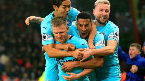 <p>               Newcastle United's Matt Ritchie, centre left, celebrates scoring his side's second goal of the game during their English Premier League soccer match against AFC Bournemouth at the Vitality Stadium, Bournemouth, England, Saturday, March 16, 2019. (Mark Kerton/PA via AP)             </p>