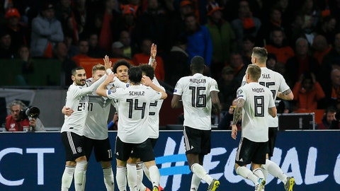 <p>               Germany's Nico Schulz, fourth from left, celebrates with his teammates after scoring his side's third goal during the Euro 2020 group C qualifying soccer match between Netherlands and Germany at the Johan Cruyff ArenA in Amsterdam, Sunday, March 24, 2019. (AP Photo/Peter Dejong)             </p>