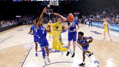 <p>               Marquette guard Markus Howard (0) goes up for a shot against Seton Hall players, from left, Romaro Gill (35), Anthony Nelson (2), Sandro Mamukelashvili (23) and Myles Cale (22) during the second half of an NCAA college basketball semifinal game in the Big East men's tournament, Friday, March 15, 2019, in New York. Seton Hall won 81-79. (AP Photo/Julio Cortez)             </p>
