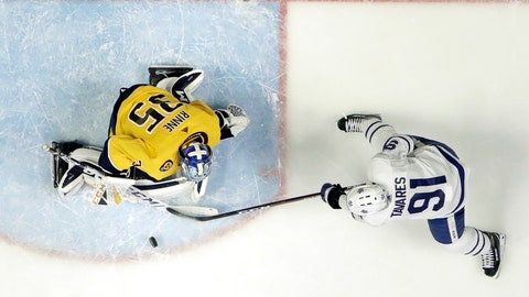 <p>               Nashville Predators goaltender Pekka Rinne (35), of Finland, blocks a shot by Toronto Maple Leafs center John Tavares (91) in the second period of an NHL hockey game Tuesday, March 19, 2019, in Nashville, Tenn. (AP Photo/Mark Humphrey)             </p>