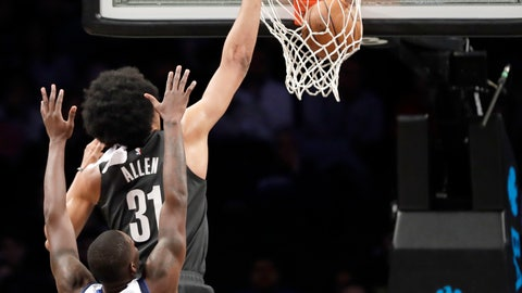 <p>               Brooklyn Nets center Jarrett Allen (31 dunks in front of Dallas Mavericks forward Dorian Finney-Smith, bottom, during the first half of an NBA basketball game, Monday, March 4, 2019, in New York. (AP Photo/Kathy Willens)             </p>