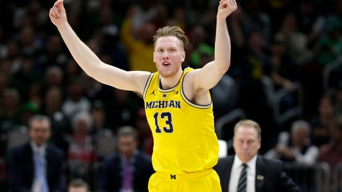 <p>               Michigan's Ignas Brazdeikis (13) reacts after shooting a 3-point basket during the first half of an NCAA college basketball championship game against Michigan State in the Big Ten Conference tournament, Sunday, March 17, 2019, in Chicago. (AP Photo/Kiichiro Sato)             </p>