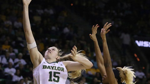 <p>               Baylor forward Lauren Cox (15) scores past Oklahoma State center Mariam Gnanou (15) in the second half of an NCAA college basketball game, Saturday, March 2, 2019, in Waco, Texas. Baylor defeated Oklahoma State 76-44. (AP Photo/Jerry Larson)             </p>