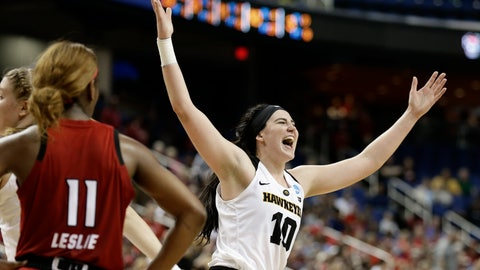 <p>               Iowa's Megan Gustafson (10) reacts as she leaves the court as North Carolina State's Kiara Leslie (11) looks on during the second half of a regional women's college basketball game in the NCAA Tournament in Greensboro, N.C., Saturday, March 30, 2019. (AP Photo/Gerry Broome)             </p>