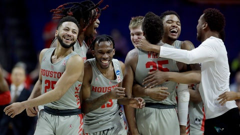 <p>               Houston players celebrate after their second round men's college basketball game against Ohio State in the NCAA Tournament Sunday, March 24, 2019, in Tulsa, Okla. Houston won 74-59. (AP Photo/Charlie Riedel)             </p>