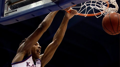 <p>               Kansas' Ochai Agbaji dunks the ball during the first half of an NCAA college basketball game against Baylor Saturday, March 9, 2019, in Lawrence, Kan. (AP Photo/Charlie Riedel)             </p>