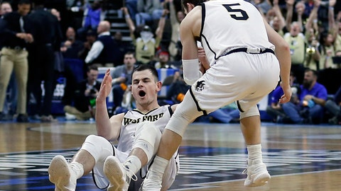 <p>               Wofford's Fletcher Magee, left, reacts after drawing a foul on a 3-point shot as Storm Murphy (5) helps him up during the first half against Seton Hall in a first-round game in the NCAA men's college basketball tournament in Jacksonville, Fla., Thursday, March 21, 2019. (AP Photo/Stephen B. Morton)             </p>