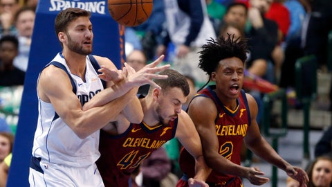 <p>               Dallas Mavericks forward Maximilian Kleber (42) competes for the ball with Cleveland Cavaliers center Ante Zizic (41) and guard Collin Sexton (2) during the first half of an NBA basketball game in Dallas, Saturday, March 16, 2019. (AP Photo/Michael Ainsworth)             </p>
