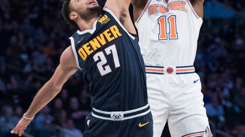 <p>               New York Knicks guard Frank Ntilikina (11) goes to the basket against Denver Nuggets guard Jamal Murray (27) during the second half of an NBA basketball game Friday, March 22, 2019, at Madison Square Garden in New York. (AP Photo/Mary Altaffer)             </p>
