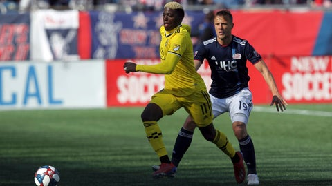 <p>               Columbus Crew's Gyasi Zardes (11) is defended by New England Revolution's Antonio Mlinar Delamea (19) during the first half of an MLS soccer game, Saturday, March 9, 2019, in Foxborough, Mass. (AP Photo/Stew Milne)             </p>