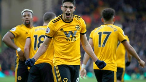<p>               Wolverhampton Wanderers' Raul Jimenez celebrates scoring his side's second goal of the game during their English Premier League soccer match against Cardiff City at Molineux, Wolverhampton, England, Saturday, March 2, 2019. (Nick Potts/PA via AP)             </p>