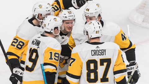<p>               Pittsburgh Penguins' Jake Guentzel (59) celebrates with teammates Sidney Crosby (87), Jared McCann (19), Erik Gudbranson (44) and Marcus Pettersson (28) after scoring during the second period of an NHL hockey game, Saturday, March 2, 2019 in Montreal. (Graham Hughes/The Canadian Press via AP)             </p>