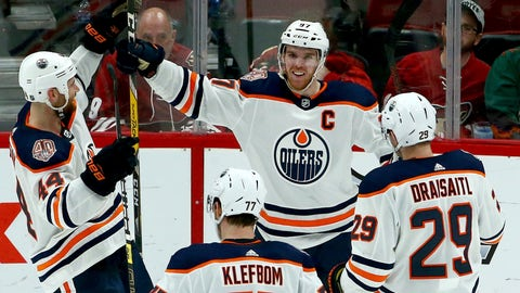 <p>               Edmonton Oilers center Connor McDavid (97) smiles as he celebrates his game-winning goal against the Arizona Coyotes with Zack Kassian (44), Oscar Klefbom (77) and Leon Draisaitl (29) during overtime of an NHL hockey game Saturday, March 16, 2019, in Glendale, Ariz. The Oilers won 3-2. (AP Photo/Ross D. Franklin)             </p>