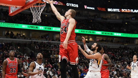 <p>               Chicago Bulls forward Lauri Markkanen (24) goes to the basket as Utah Jazz guard's Donovan Mitchell (45) and guard Ricky Rubio (3) defend him during the first half of an NBA basketball game Saturday, March 23, 2019, in Chicago. (AP Photo/David Banks)             </p>
