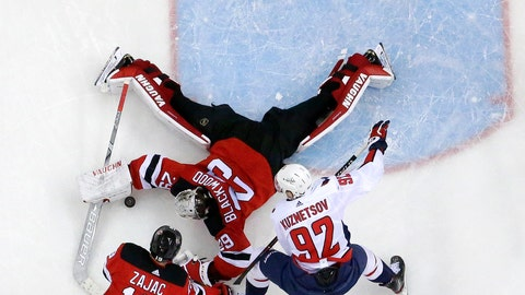 <p>               New Jersey Devils goaltender MacKenzie Blackwood (29) dives to make a save against Washington Capitals center Evgeny Kuznetsov (92), of Russia, during the third period of an NHL hockey game, Tuesday, March 19, 2019, in Newark, N.J. Devils' Travis Zajac (19) helps defend on the play. The Capitals won 4-1. (AP Photo/Julio Cortez)             </p>