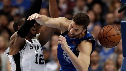 <p>               San Antonio Spurs center LaMarcus Aldridge (12) dunks as Dallas Mavericks forward Maximilian Kleber (42) defends during the second half of an NBA basketball game in Dallas, Tuesday, March 12, 2019. (AP Photo/Tony Gutierrez)             </p>