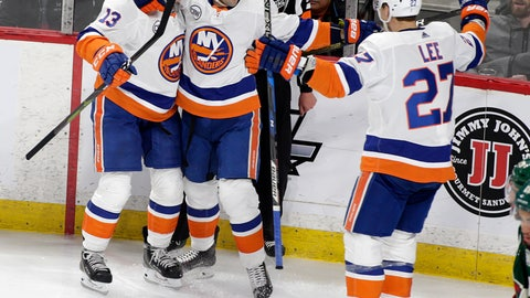 <p>               New York Islanders right wing Jordan Eberle (7) celebrate his first period goal of an NHL hockey game against the Minnesota Wild with teammates Mathew Barzal (13) and Anders Lee (27) Sunday, March 17, 2019, in St. Paul, Minn. (AP Photo/Paul Battaglia)             </p>