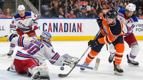<p>               New York Rangers goaltender Alexandar Georgiev (40) stops Edmonton Oilers' Colby Cave (12) as Neal Pionk (44) and Marc Staal (18) look on during the second period of an NHL hockey game, Monday, March 11, 2019, in Edmonton, Alberta. (Amber Bracken/The Canadian Press via AP)             </p>