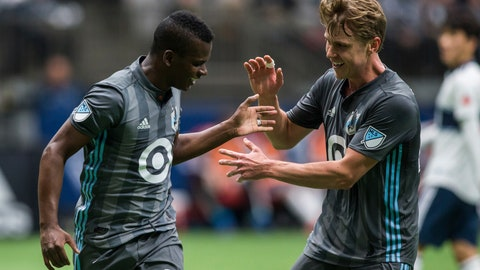 <p>               Minnesota United's Carlos Darwin Quintero (25) celebrates his goal with Rasmus Schuller during the first half of an MLS soccer match against the Vancouver Whitecaps on Saturday, March 2, 2019, in Vancouver, British Columbia. (Ben Nelms/The Canadian Press via AP)             </p>