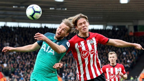 Tottenham Hotspur's Harry Kane left and Southampton's Jannik Vestergaard battle for the ball during the English Premier League soccer match at St Mary's Stadium Southampton England Saturday