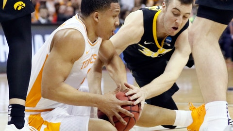 <p>               Tennessee's Grant Williams, left, and Iowa's Connor McCaffery battle for the ball in the first half during a second-round men's college basketball game in the NCAA Tournament in Columbus, Ohio, Sunday, March 24, 2019. (AP Photo/John Minchillo)             </p>