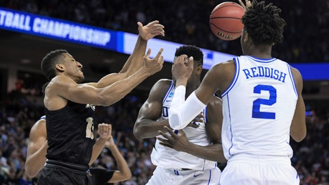 <p>               Central Florida guard Aubrey Dawkins, left, battles for a rebound against Duke's Zion Williamson, and Cam Reddish (5) after missing a potential game-winning tip-in during the second half of a second-round game in the NCAA men's college basketball tournament Sunday, March 24, 2019, in Columbia, S.C. Duke defeated Central Florida 77-76. (AP Photo/Sean Rayford)             </p>