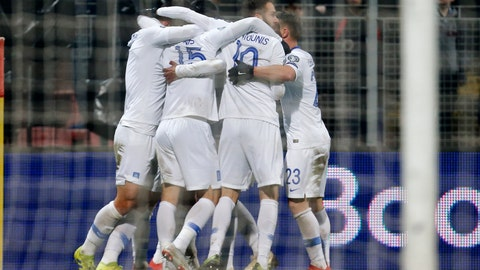 <p>               Greek players celebrate their team's second goal during the Euro 2020 group J qualifying soccer match between Bosnia-Herzegovina and Greece in Zenica, Bosnia, Tuesday, March 26, 2019. (AP Photo/Darko Bandic)             </p>